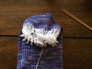 Waste yarn holding the sock toe stitches